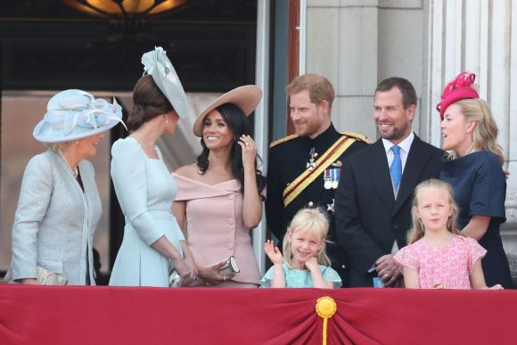 LONDON, ENGLAND - JUNE 09:  Camilla, Duchess Of Cornwall, Catherine, Duchess of Cambridge, Meghan, Duchess of Sussex, Prince Harry, Duke of Sussex, Peter Phillips, Autumn Phillips, Isla Phillips and Savannah Phillips on the balcony of Buckingham Palace during Trooping The Colour on June 9, 2018 in London, England. The annual ceremony involving over 1400 guardsmen and cavalry, is believed to have first been performed during the reign of King Charles II. The parade marks the official birthday of the Sovereign, even though the Queen's actual birthday is on April 21st.  (Photo by Chris Jackson/Getty Images)